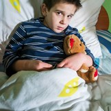 An adopted child dealing with bedwetting.