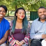 An adoptive mom and dad meet with their child's birthmom.