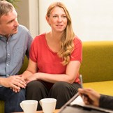An adoptive mom and dad talk to a therapist about their marriage related to their adoption.